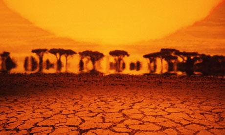 Kenya, mirage in desert, sunset