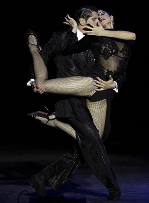 Argentina's Cristian David Correa, left, and Sabrina Amuchastegui compete during the 2012 Tango Dance World Cup stage finals in Buenos Aires, Argentina, Tuesday, Aug. 28, 2012. Couples from around the world competed in the finals Argentina's annual tango competition, the highlight of a two-week festival which this year honored Astor Piazzolla, the legendary composer and bandoneonista who revived the genre and infuriated purists by blending tango with rock music in the 1970s. (AP Photo/Natacha Pisarenko)