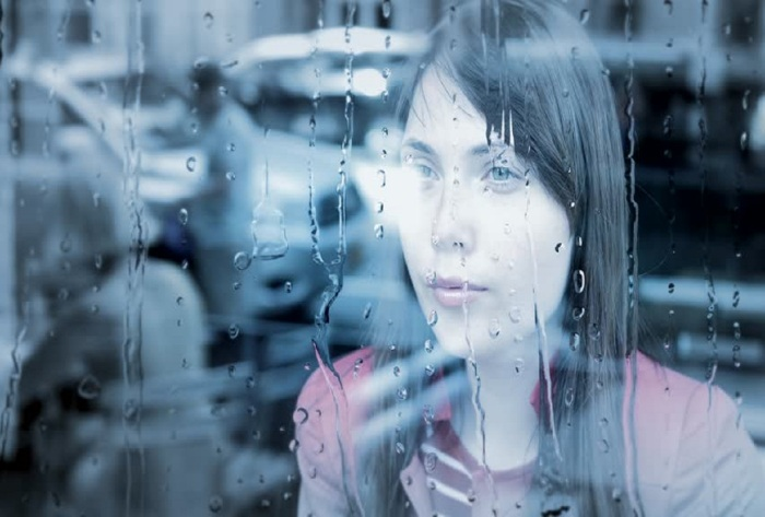 woman in rain shutterstock com